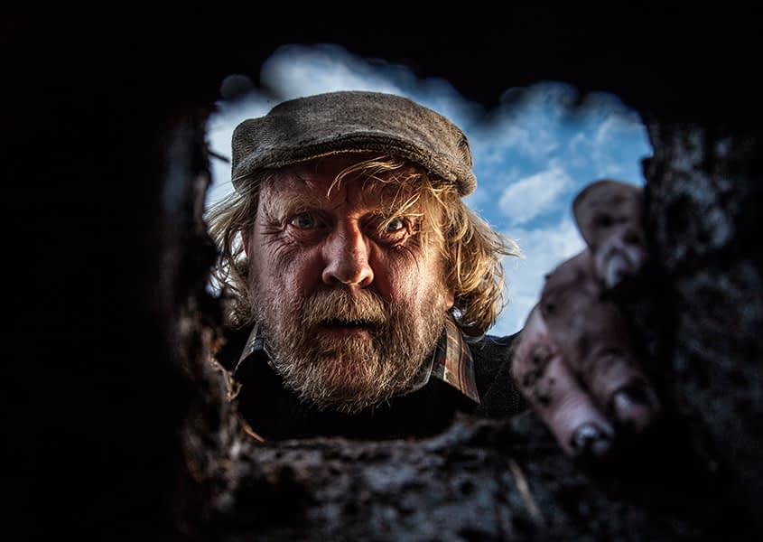 Movie, still, actor, farmer, digging, hole, bog, photographer Dublin