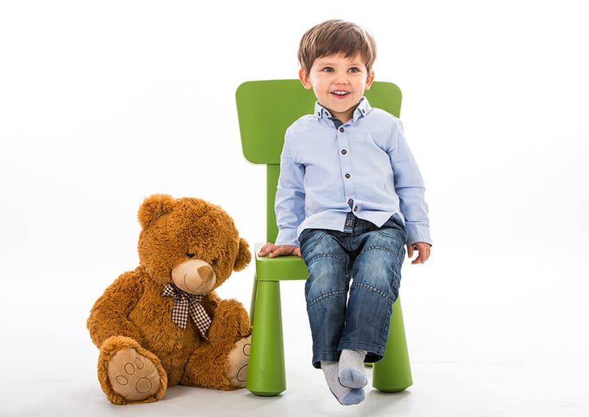 boy, teddy, portrait, studio, chair, laughing, glasses